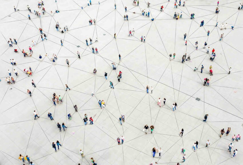 People on a gray surface connected by network lines indicating a real-time payment network