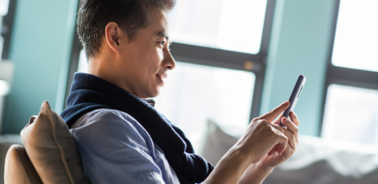 a Consumer on a mobile device representing Digital Transformation Strategy