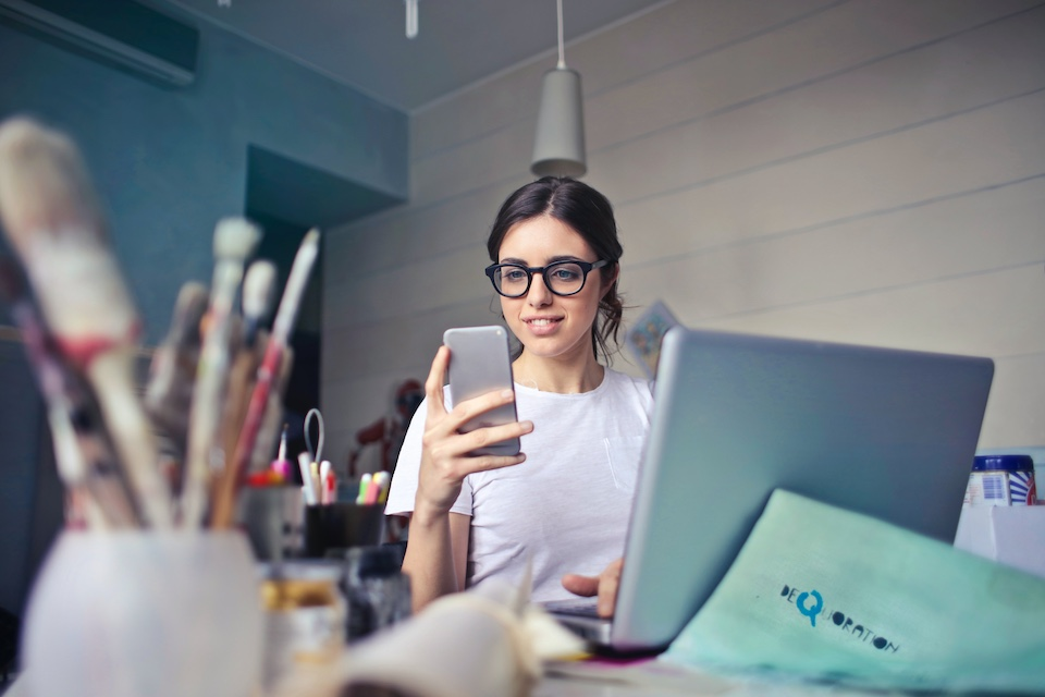 A graphic designer recieving an instant payout on her phone