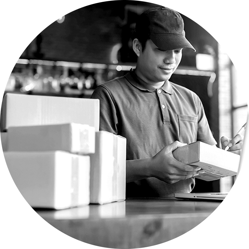 An eCommerce business owner processing payments and sending products.