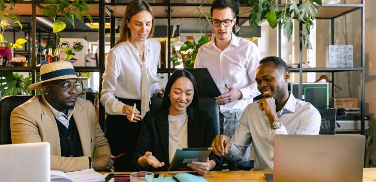 Diverse professionals meet in a modern office