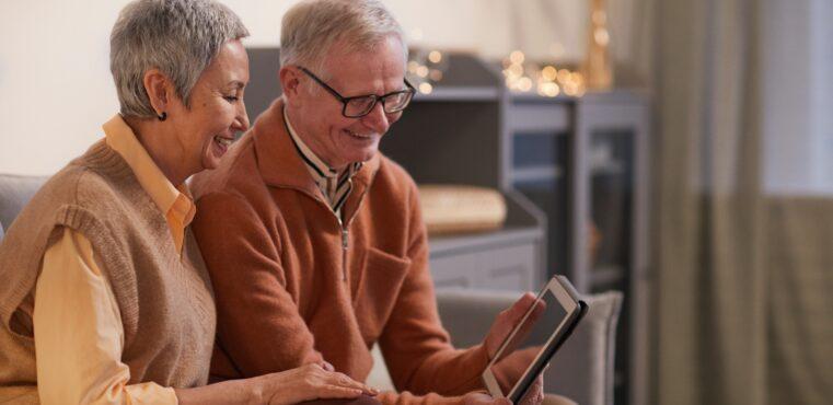 Senior couple holds ipad for eCommerce